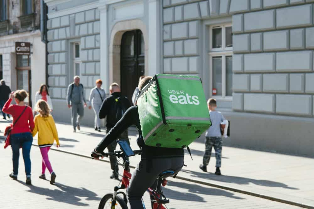 A picture of an Uber eats rider using food service delivery platform