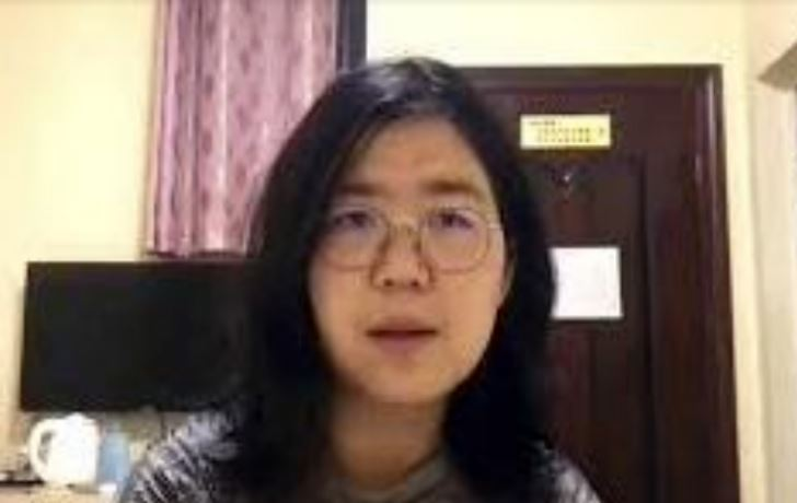 journalist arrested for exposing wuhan covid cover up being force fed and restrained in shanghai prison